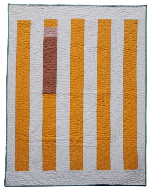 California QuiltNew and vintage cottons come together in a bold strip quilt style. The bright modern color palette is softened with subtle accent strips, a select few are naturally dyed with onion skins.  (Image from Folk Fibers)